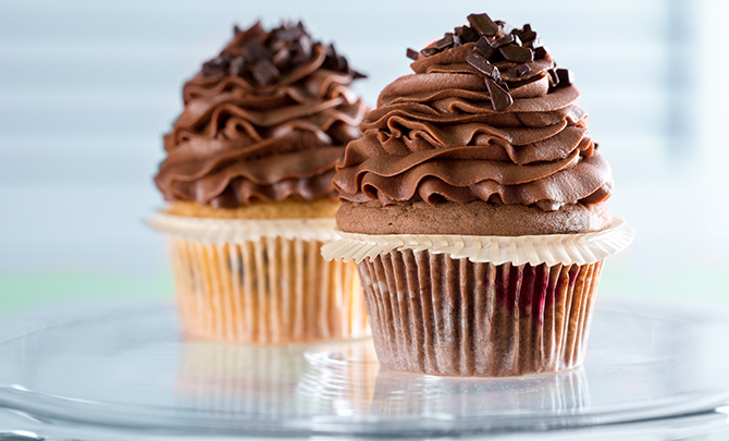 Two cupcakes with chocolate frosting from the Dollar Photo Club collection